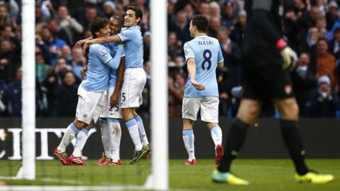 Pemain Manchester City merayakan gol ke gawang Arsenal
