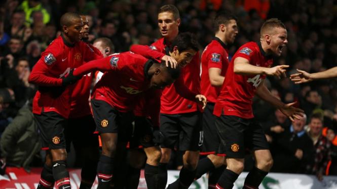 Para pemain Man.United merayakan gol ke gawang Norwich City.