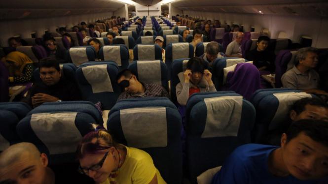 Suasana di kabin pesawat (ilustrasi)
