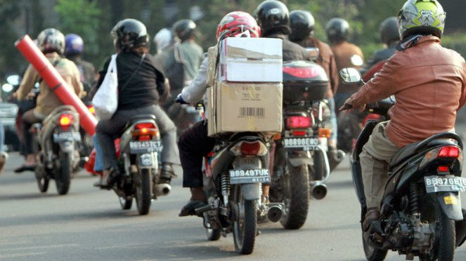 Pengendara sepeda motor. Foto ilustrasi.