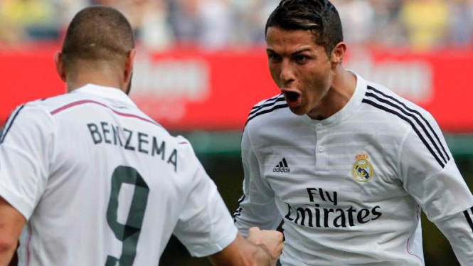 Pemain Real Madrid, Cristiano Ronaldo, merayakan gol