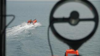 Ilustrasi pencarian korban tenggelam.