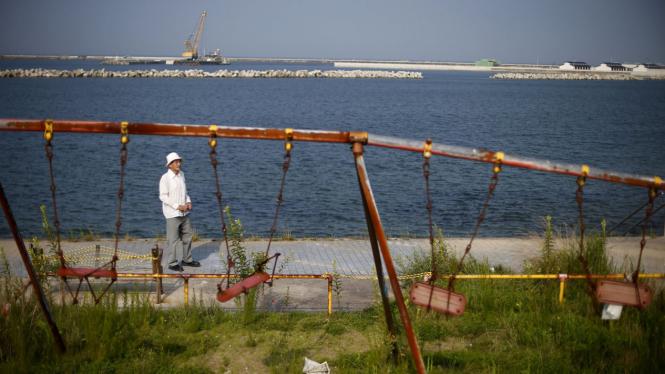 Ilustrasi Fukushima saat menolak pembangunan kembali pusat Reaktor Nuklir di Fukushima Jepang
