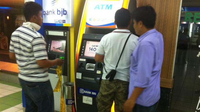 Ilustrasi mesin ATM.
