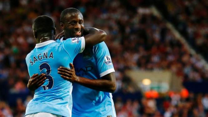 Yaya Toure merayakan gol Manchester City