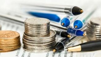 Ilustrasi mengelola keuangan.
