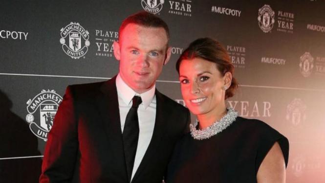 Wayne Rooney dan Coleen Rooney.