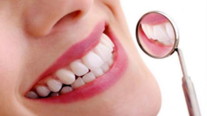 Empat Cara Putihkan Gigi Kuning Akibat Minum Kopi Viva