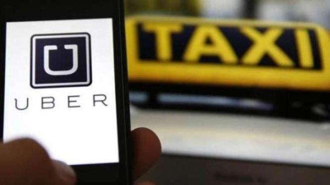 Ilustrasi Layanan taksi berbasis aplikasi online, Uber.