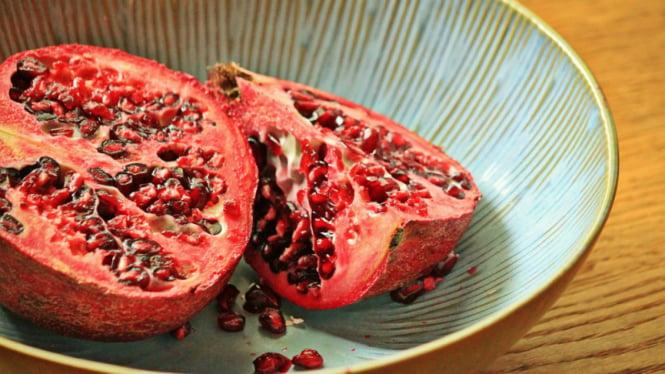 Ilustrasi buah delima.