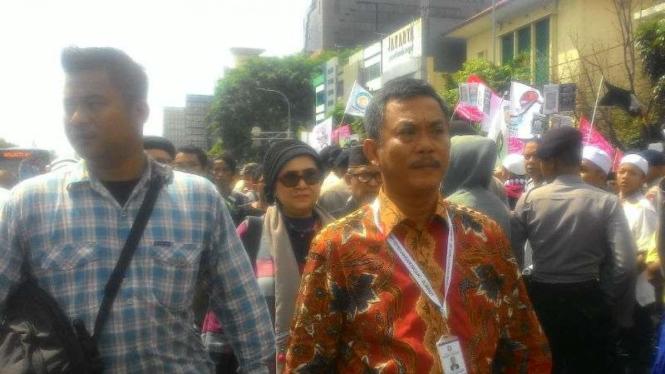 Ketua Tim Pemenangan Ahok-Djarot, Prasetio Edi Marsudi (baju batik)