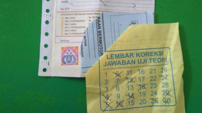 Lembar koreksi ujian tertulis SIM C.