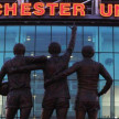 Patung The Holy Trinity, ikon markas MU, Old Trafford