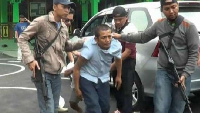 Ramlan Butarbutar saat ditangkap Polresta Depok pada 15 Agustus 2015.