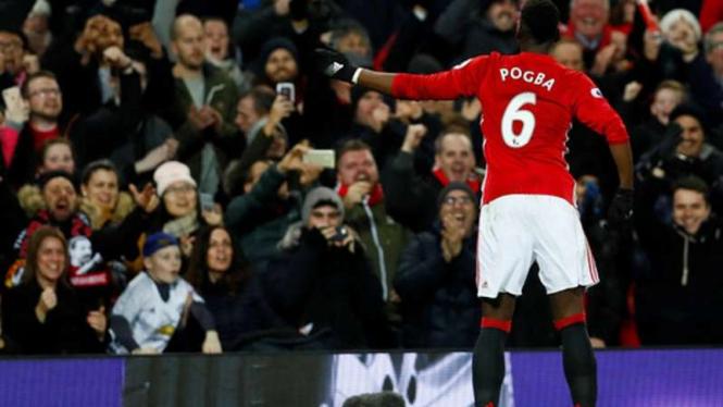 Gelandang Manchester United, Paul Pogba, saat rayakan gol.
