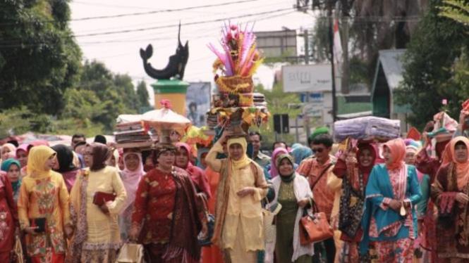 Ilutrasi tradisi babako.