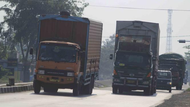 Ilustrasi truk logistik pengiriman barang.