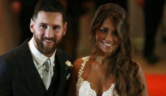 Lionel Messi dan istrinya, Antonella Roccuzzo