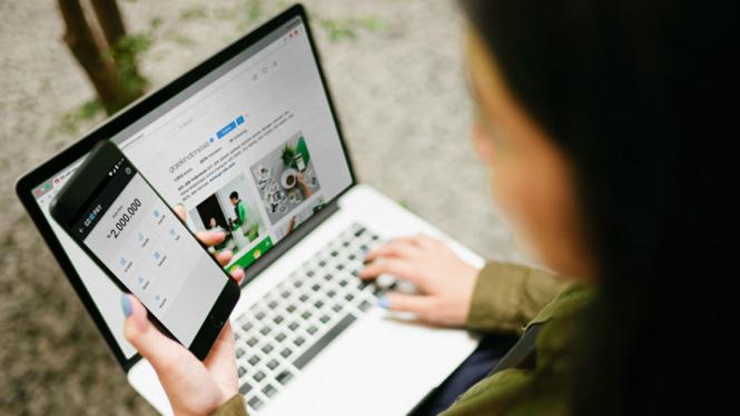 Ilustrasi pemakaian Gojek.