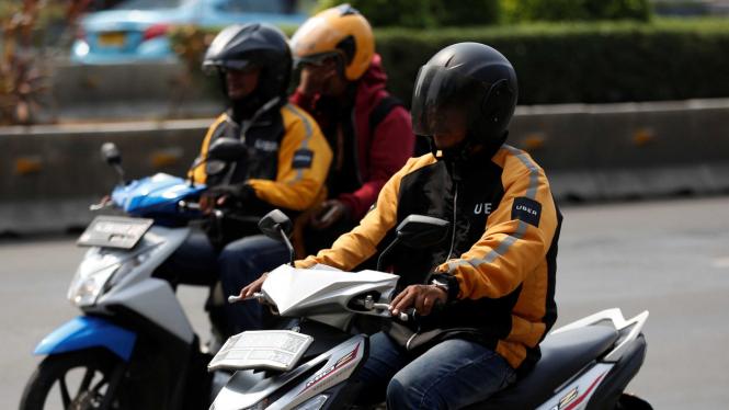 sorot ojek online - transportasi online - ojek uber