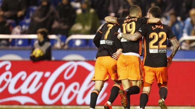 Pemain Valencia rayakan gol