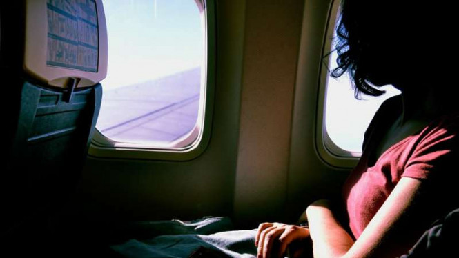 Ketakutan saat naik pesawat terbang.