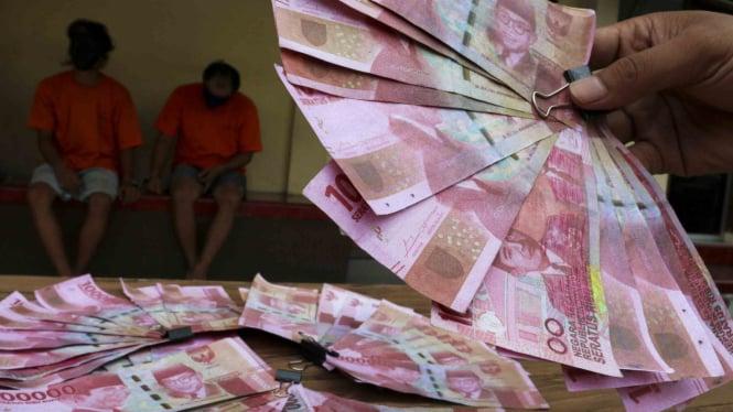Barang bukti uang palsu