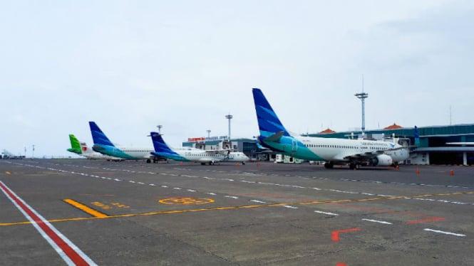 Maskapai Garuda Indonesia dan CItilink di Bandara Ngurah Rai, Denpasar, Bali