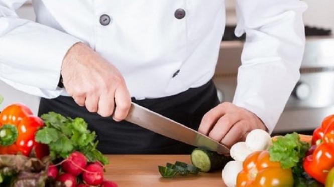 Ilustrasi memasak di dapur.
