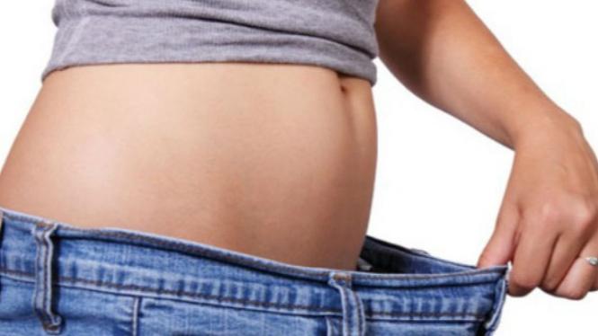 Menghilangkan perut buncit.