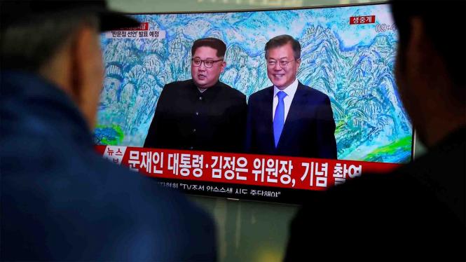 Pemimpin Korea Utara Kim Jong Un dan Presiden Korea Selatan Moon Jae In