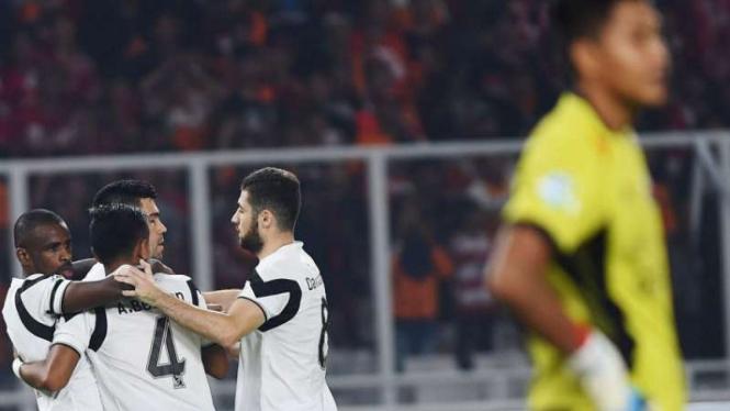 Pemain Madura United rayakan gol ke gawang Persija Jakarta.