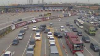 Ilustrasi  gerbang Tol Cikarang Utama saat satu arah dari Tol Cipali.