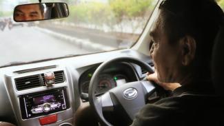 Grab Kewalahan Hadapi Lonjakan Permintaan Taksi Online