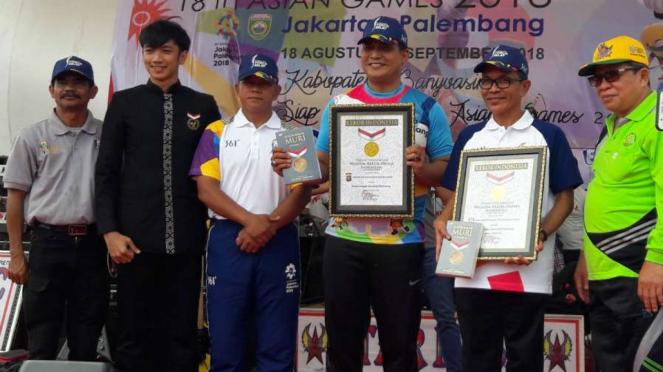 Rekor MURI bendera Asian Games sepanjang 7 kilometer