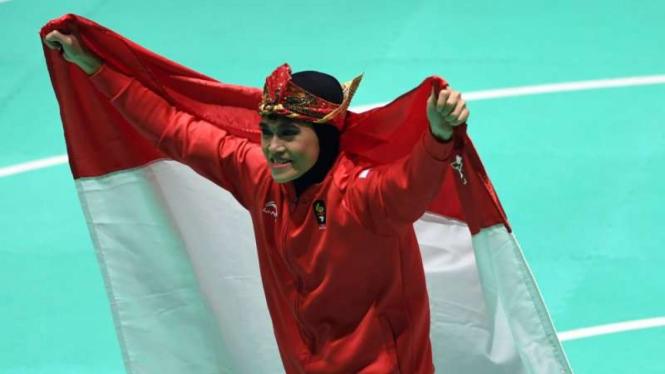 Pesilat Indonesia Puspa Arumsari meraih emas di Asian Games 2018.