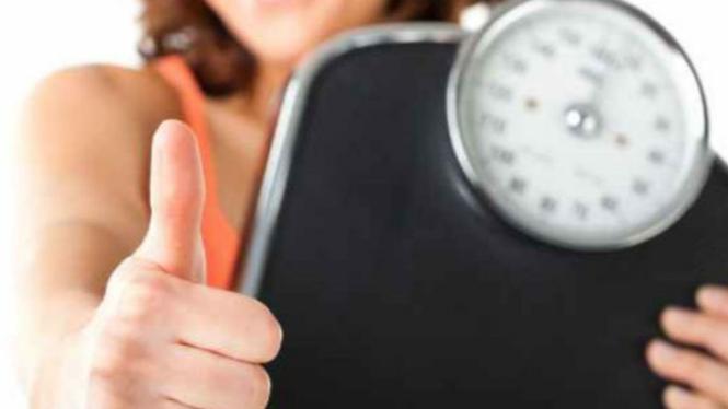 Ilustrasi menurunkan berat badan.