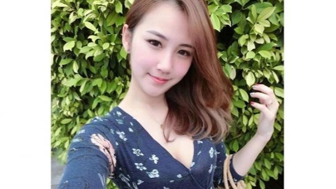 Model cantik bernama Qi Min Lan.
