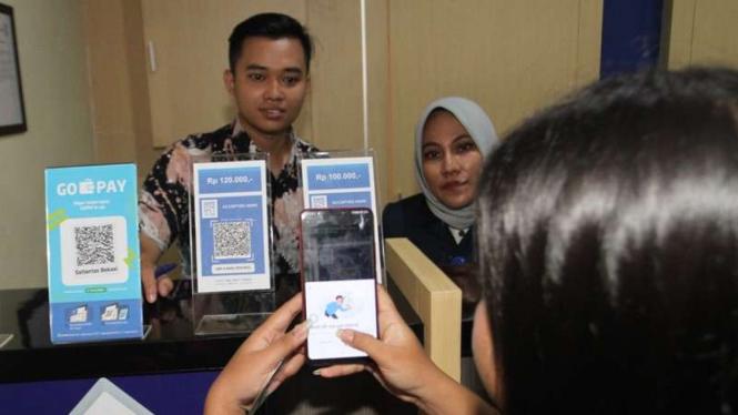 Gopay bisa untuk bayar SIM dan SKCK di Bekasi, Jawa Barat.