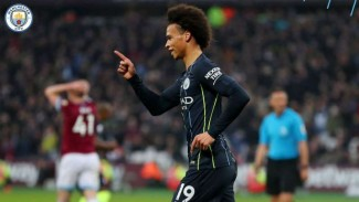 Pemain Manchester City, Leroy Sane rayakan gol.