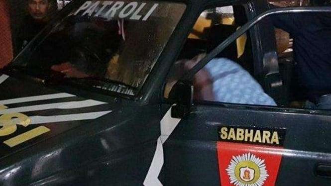 Mobil patroli yang digunakan oknum polisi untuk mengangkut 130 kilogram ganja.