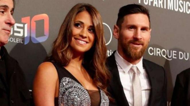 Lionel Messi dan istrinya Antonella Roccuzzo.