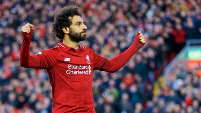 Winger Liverpool, Mohamed Salah, melakukan selebrasi usai mencetak gol