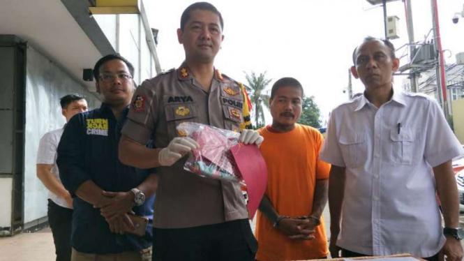 Hari Kurniawan, tersangka kasus pembunuhan terhadap anak tirinya di Depok.