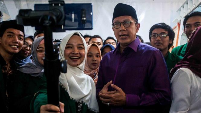 Menteri Agama, Lukman Hakim Saifuddin (kanan)
