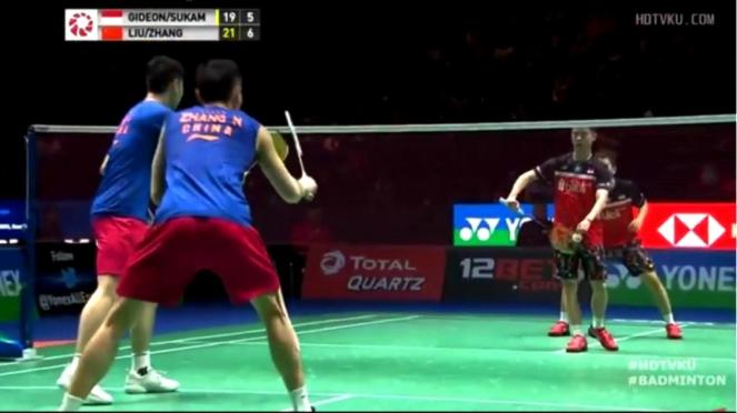 Kevin Sanjaya/Marcus Gideon kontra Zhang Nan/Liu Cheng di babak I All England