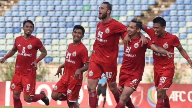 Pemain Persija Jakarta merayakan kemenangan.