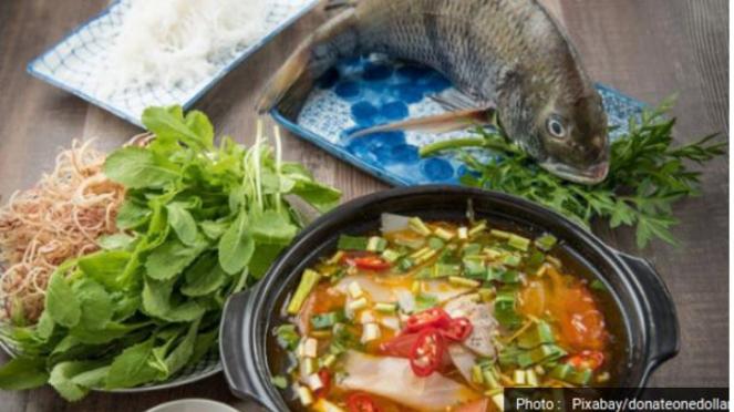 Ilustrasi kuliner Asia/olahan ikan/memasak ikan.