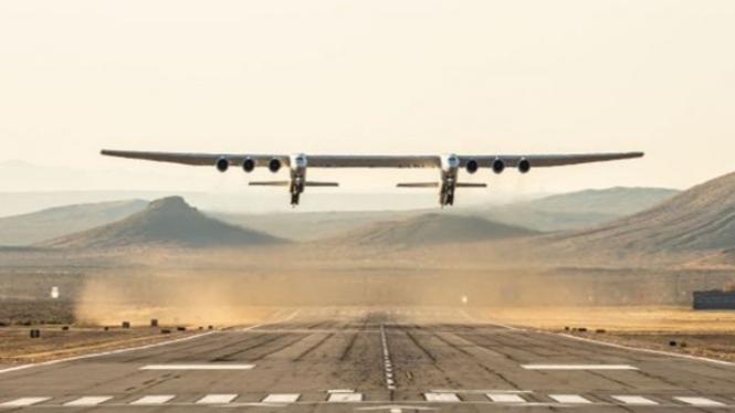 Pesawat terbang.