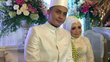 Muzdalifah dan suami baru.